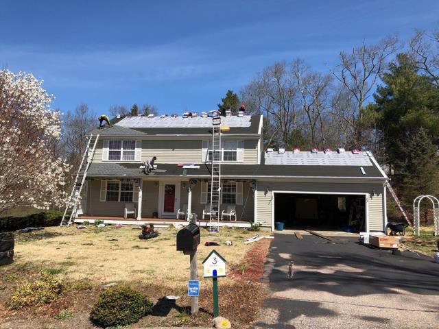 Westerly, RI - All of the old worn out and wind damaged shingles have been removed and the crew is now installing all the GAF Accessories as part of the golden pledge warranty! Skylights are being replaced with new Velux skylights. The new GAF Timberline HDZ shingles are also starting to get installed.