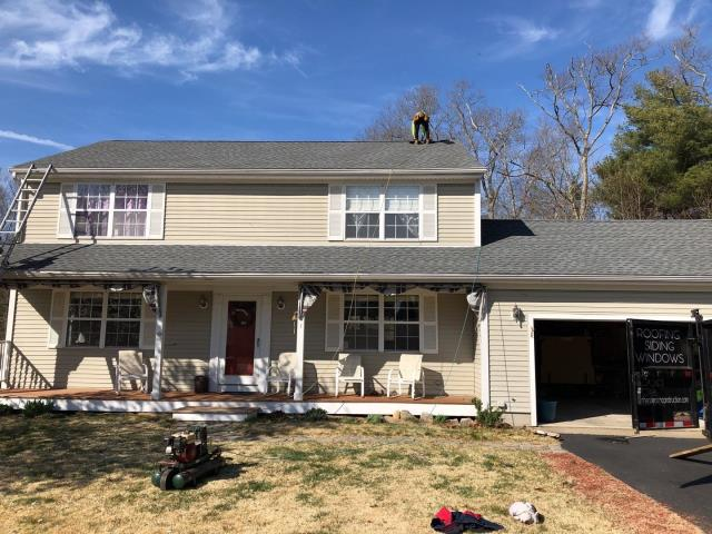Westerly, RI - This full roof replacement in Westerly RI Is done! New roof no mess! new Roof in One day! Golden pledge warranty for this roof that was damaged from high winds. 50 year warranty.