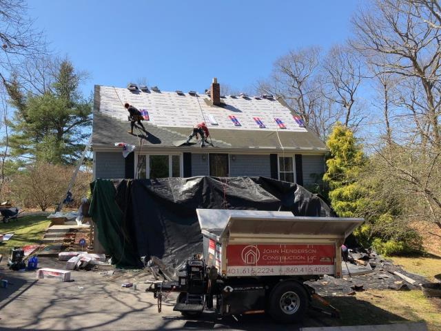Westerly, RI - Crew has installed all the GAF ice an water and synthetic roofing paper. Now we are starting to install the new GAF Timberline HDZ roof shingles.