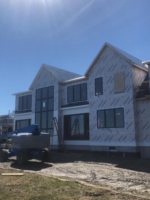 Narragansett, RI - This New construction project in Narragansett RI is watertight after having Grace Ice & Water installed using Stinger cap system. New Owens Corning roof shingle to be installed next. And Drexel Standing Seam metal roofing
