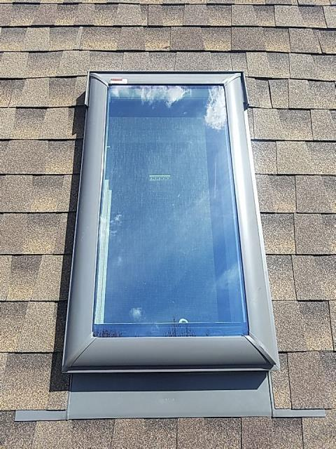 Charlestown, RI - Replaced an old leaking Skylight on this property today  in Charlestown RI. Matched old shingles with new GAF HDZ shingles,