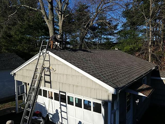 Groton, CT - Crew is back in Groton Ct roofing today. Finishing this detached garage with new GAF Timberline HDZ shingles. Mission Brown is color. Roof replacement Groton CT