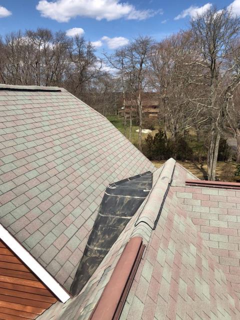 Narragansett, RI - On a roof in Narragansett RI inspecting some tricky areas for proper flashing. This roof is on the schedule now to be completely replaced using GAF Timberline HDZ shingles. Accents of standing seam metal roof also may be used.