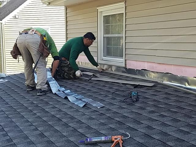 Groton, CT - After this roof replacement was done we are back making repairs to the siding and roof to wall flashing. This roof now qualifies for the Golden Pledge warranty.