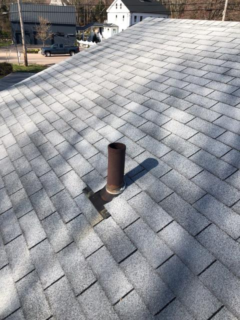 Westerly, RI - Roof replacement in westerly RI. This old rusty steel vent pipe will be replaced with a Lifetime Tool Easy sleeve and Ultimate pipe flashing. Roof will have a true 50 year warranty that covers all GAF material used and GAF even covers all the Lifetime tool accessories on this roof with the Golden Pledge Warranty!