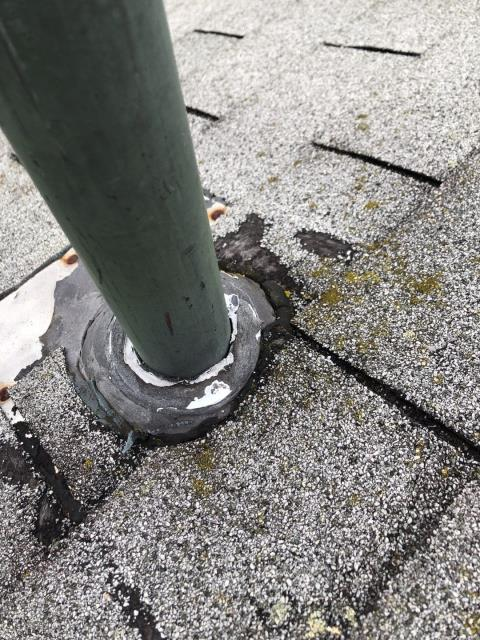 Montville, CT - This old dried out pipe flashing need to be replaced. Water is getting into the house around the dried out collar and causing a stain of the ceiling. A new ultimate pipe boot should be installed along with a full roof replacement using GAF timberline HDZ shingles.