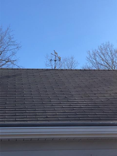 Salem, CT - These three tab shingles are drying out and curling up. Time to replace this roof before more leaks develop.