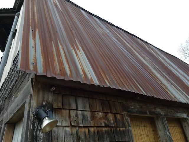 North Stonington, CT - Measuring a metal roof on a barn in North Stonington CT. This roof was damaged by high winds. Looking at replacing the old metal with a new drexel standing seam metal roof.