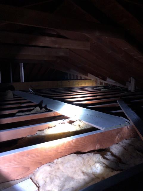 Montville, CT - Inspecting an attic in Montville CT for proper ventilation. We will be adding new ridge vent to allow more ventilation and add years to the life of this roof.