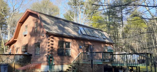 Exeter, RI - Sunday roof inspections! This log cabin is in need of a roof replacement. A new GAF roof system is being put together to see if its the right fit. Skylight replacement also