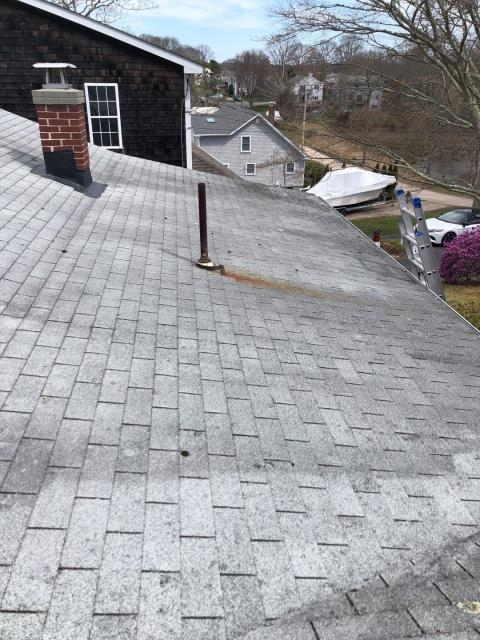Richmond, RI - Roof inspection in Richmond RI. This low pitch area will have full ice & Water Shield installed  for maximum protection. New lead chimney flashing and the Lifetime ultimate pipe boot will be installed as part of this GAF roof system.