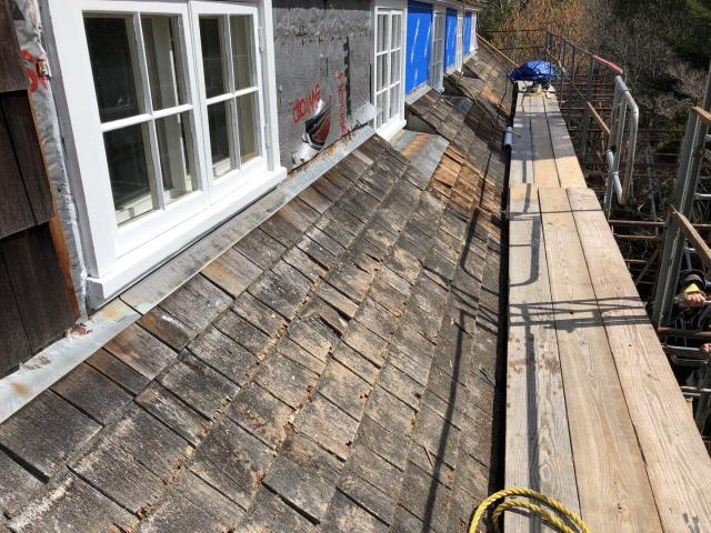 South Kingstown, RI - This wood roof replacement project is going great! On to one of the last areas of this roof that need to be removed before the new red cedar shakes are installed.