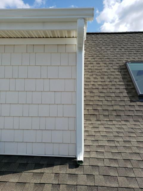 Charlestown, RI - Gutter replacement in Charlestown RI. Installed new white seamless gutters and down spouts