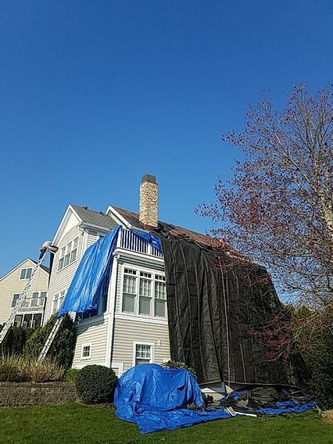 Narragansett, RI - Crew is on site this morning in Narragansett RI working on this full roof replacement.Heavy duty canvas tarps are set up to protect the property. New Roof one day! New roof no mess! Full GAF Roof system installed