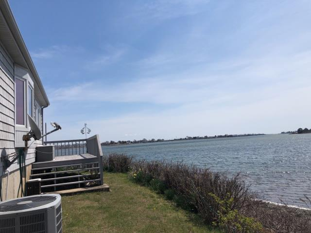 South Kingstown, RI - What a view at this property! This home is in a high wind location along the shore of South Kingstown Rhode Island. We are on site to repair the roof. Shingles have blown off from the high winds. We will cover the damaged areas with a tarp and start working with the homeowners insurance company to get this roof damage covered. The GAF timberline HDZ roof shingle is a great option in a high wind area like this. There is unlimited wind protect with this shingle!