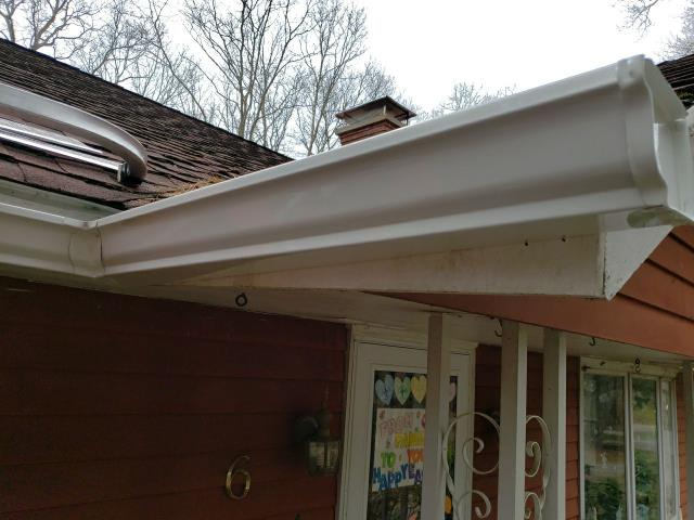 Hopkinton, RI - Installed new white seamless gutters on this house in Hopkinton RI. Stainless steel gutter guards