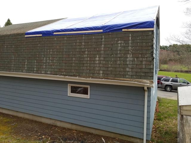 Preston, CT - Roof damage from a fallen tree branch in Preston Ct. This roof will need structural repairs before the new Roof replacement is completed. New seamless gutters will need to be installed to replace the damaged gutters.