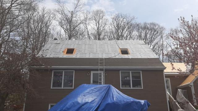 Stonington, CT - This roof in Pawcatuck Ct is in process! Old shingles have been removed and old leaking skylights are being replaced. This roof is getting the golden plege warranty. Using all GAF accessories as part of this GAF roof system in Pawcatuck