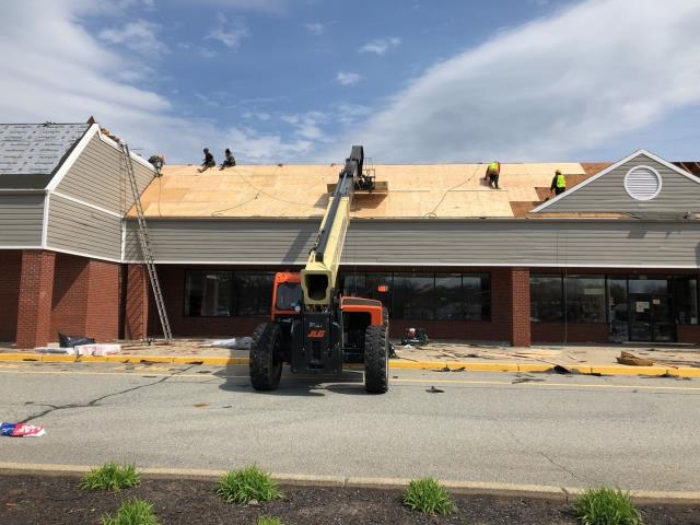 North Kingstown, RI - This commercial roof replacement in North Kingstown RI is underway. We are replaceing over 600 sheets of Damaged  5/8 cdx plywood. We need to have solid nailing for our GAF Roof system.