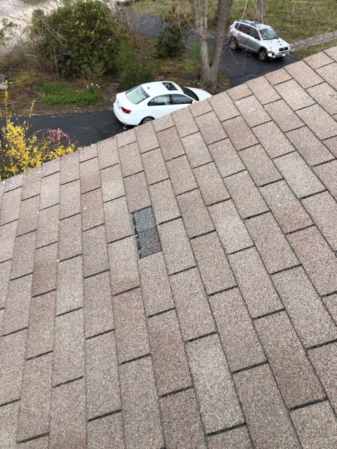 Narragansett, RI - Missing Shingles on this roof in the high wind zone of Narraganstt RI.Old three tab shingles are more likely to sustain wind damage. Using GAF Timberline HDZ roof shingles is a great option. GAF Timberline HDZ  shingles have a no wind limit warranty