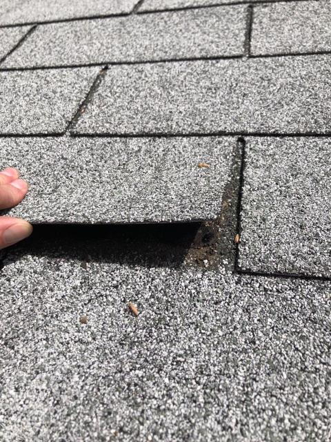 Richmond, RI - In Richmond RI on a custmers roof who saw our crew do a neighbors roof and wanted a free inspection! These three tab shingles are dried out and no longer sealed properly.A full GAF Roof system being installed after removing the old shingles is a great option for this home.
