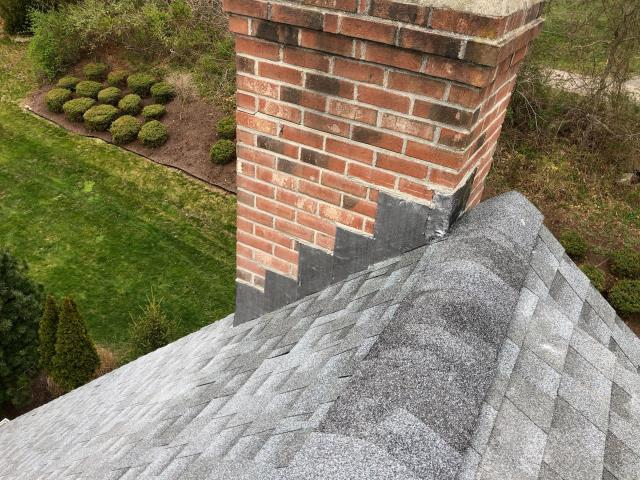 Richmond, RI - All new lead flashing installed on this chimney in richmond RI. This new roof was installed using Gaf timberline shingles. It is always best to replace the chimney flashing when replacing the roof.