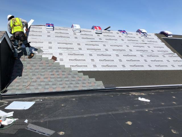 North Kingstown, RI - Crew is getting close to completeing this commercial roof replacement In North Kingstown RI. Installing a full GAF roofing system with a Golden Pledge warranty