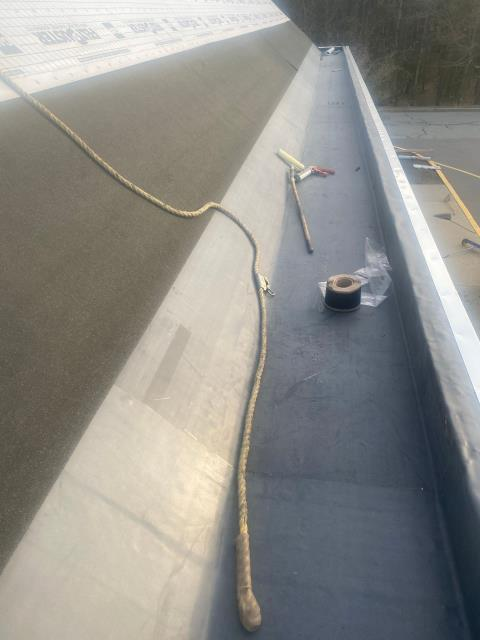 North Kingstown, RI - EPDM is installed and the GAF accessories are being installed.