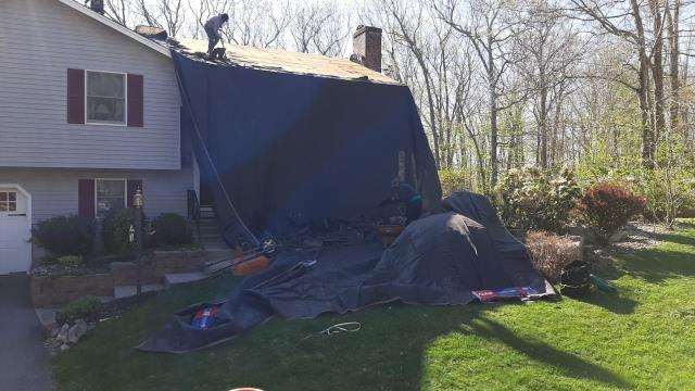 Ledyard, CT - Full roof replacement in Ledyard CT. Crew is removing two layers of old roof shingles and then will be installing a new GAF roof system.