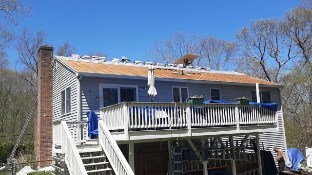 Ledyard, CT - Roofing crew is moving along on this roofing project in Ledyard CT. Carpenters are replacing some damaged plywood before the new GAF roof system is installed