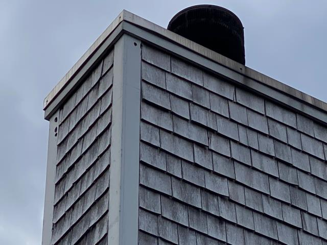 Charlestown, RI - Carpenters will be replacing this damaged wood. Woodpeckers have damaged the corner boards on this home in Charlestown RI. We will replace Using AZEK PVC.