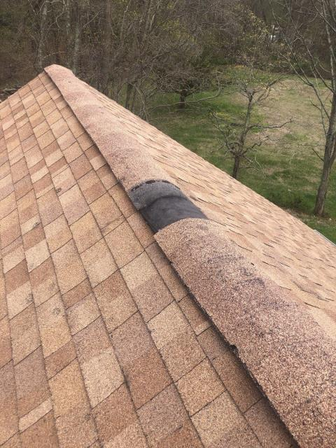 Ledyard, CT - Measuring a roof that needs to be replaced in Ledyard CT. Missing cap shingles from the high winds will repaired temporarily to keep water out the attic until the roof can be fully replaced.A new GAF Roof system with a 50 year warranty will be installed.