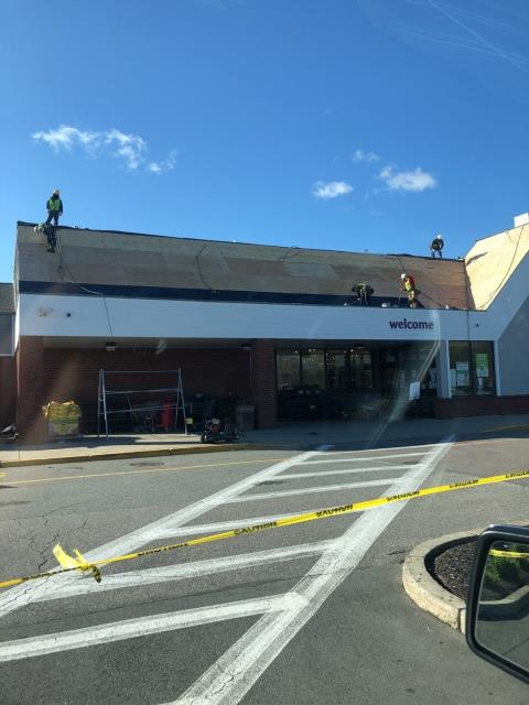 North Kingstown, RI - Installing all new Plywood on this commercial storefront roof in North Kingstown RI. All new EPDM rubber membrane being installed as needed.