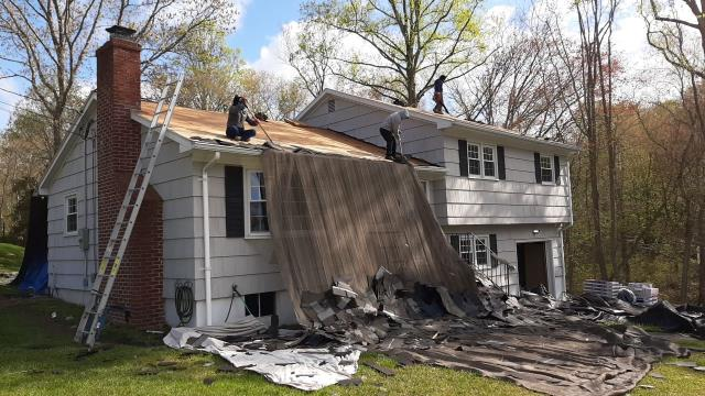 Ledyard, CT - Roofing crew has set up heavy duty tarps to protect this property in Ledyard Ct during its roof replacement.