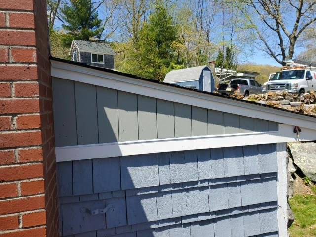 East Lyme, CT - New vertical wood siding and PVC Trim installed On this House in East Lyme CT.