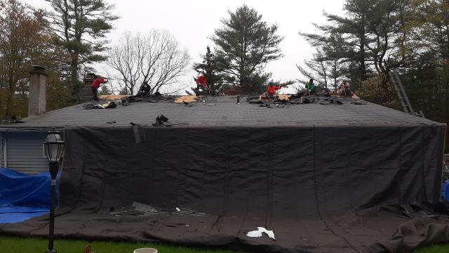 Voluntown, CT - Crew is setting up tarps to protect this home from damage. All debris will be removed as part of this full roof replacement in Voluntown CT.