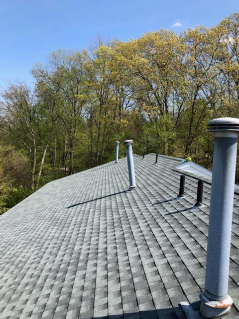 Johnston, RI - Roof repair in Johnston RI. Sealing leaking vent pipes on a recently completed Condo Roof replacement project.