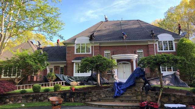 Warwick, RI - Crew is safely harnessed off and ready to start removing the defective shingles on this home. These shingles are less then 8 years old! We will be replaceing with a new GAF Timberline HD roof system
