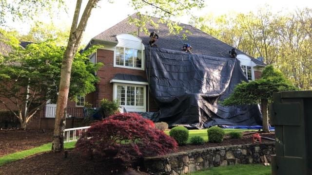 Warwick, RI - Crew is setting up heavy duty tarps to protect this property in East Greenwich RI. keeping the property protected and clean is a huge part of having a successful experience replacing your roof!
