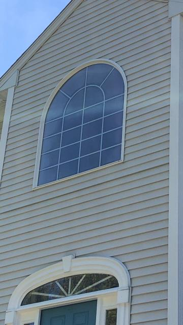 Hopkinton, RI - Measuring for new Harvey Replacement Windows and Vinyl siding in Hopkinton RI.