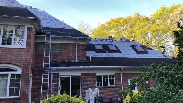 Warwick, RI - Roof replacement in East Greenwich RI is under way and making great progress! New GAF roof system being installed.