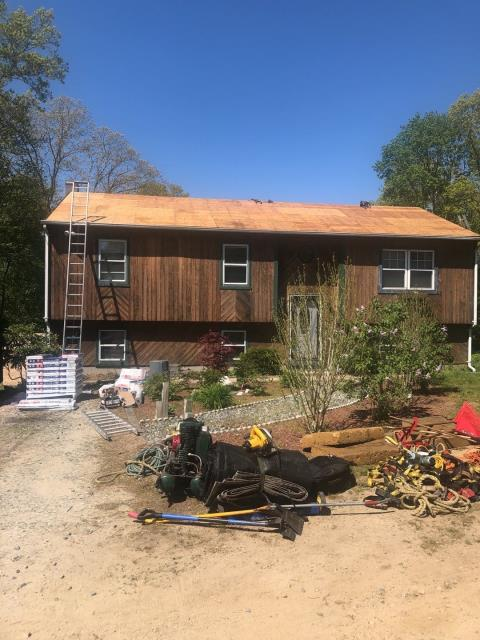 Hopkinton, RI - All the old roof shingles have been removed. All the plywood on this roof is dry rotten and under sized for the spacing of the rafters. New sheathing is required. Before the new GAF Timberline HDZ shingles get installed.
