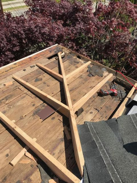 Westerly, RI - Flat roof did not have enough pitch. We are framing porch roof adding more pitch to allow water to flow properly. Installing new EPDM rubber roof system in Westerly RI.