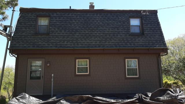 Westerly, RI - Crew is making progress on this roof replacement project in Westerly RI. New GAF Timberline ULTRA HD shingles being installed.