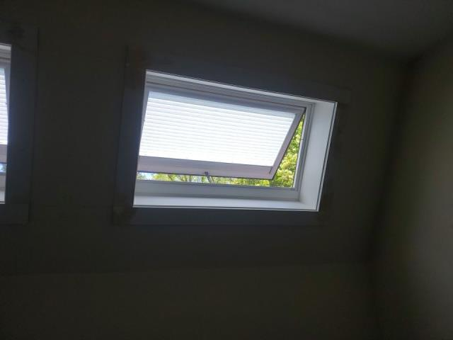 South Kingstown, RI - Trimming interior of new Velux skylights that were installed in South Kingstown RI during a recent roof replacement.