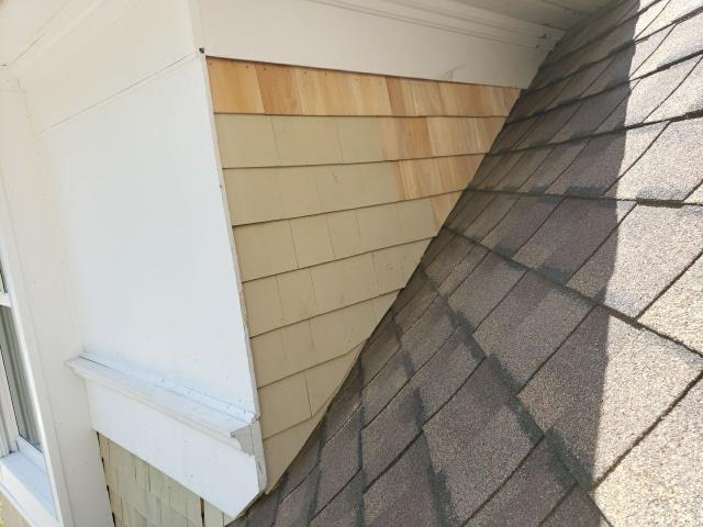 Westerly, RI - Repairing wood shake siding that was removed during the roof replacement on this property In Westerly RI. All new step flashing was installed with the new GAF Timberline Ultra HD shingles.