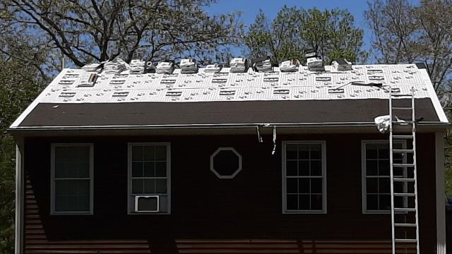 Charlestown, RI - Roof replacement in Charlestown RI. m Old roof shingles have been removed, new Tiger Paw paper installed. Two rows of ice & water installed to prevent ice dams. All GAF Products being used. GAF Timberline shingles will be installed.