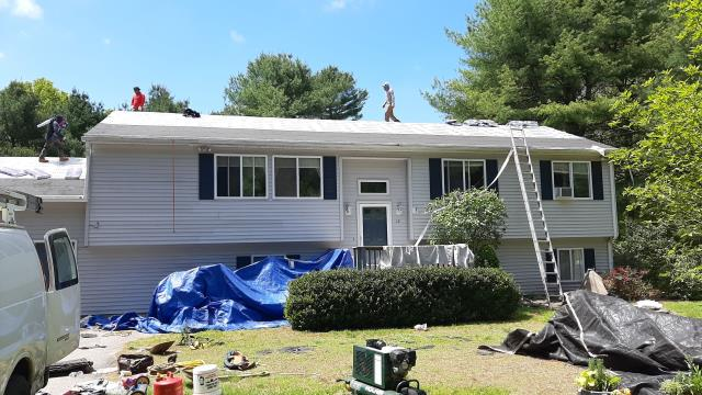 Hopkinton, RI - Old roof shingles have been been removed on this House in Hopkinton RI. All GAF Accessories are installed and guys are loading roof with new GAF Timberline HDZ roof shingles.