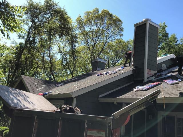 Groton, CT - Our roofing crew is hard at work installing the new GAF Timberline shingles on this condo in Groton CT.