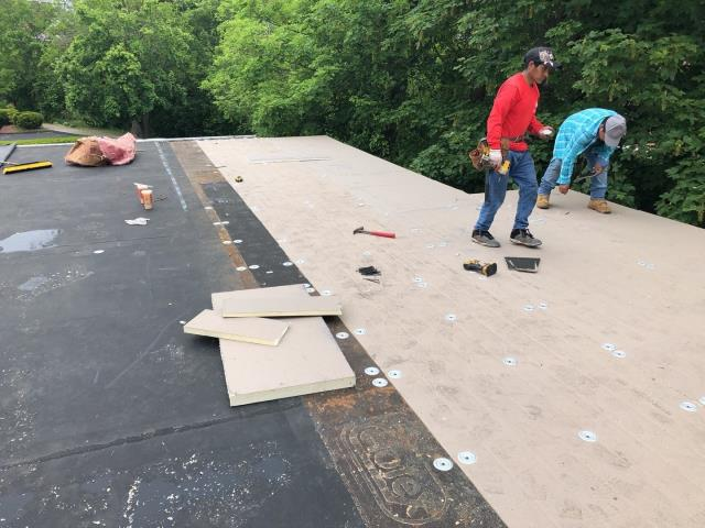 Stonington, CT - Commercial flat roof repair in Pawcatuck CT. Installing new EPDM rubber after reframing damaged roof system.